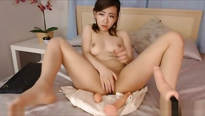 Japanese Babe Goes Wild On Intercourse Machine