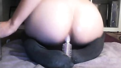 This isn't how to use a hair brush.