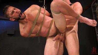 Gay men in rough bondage scenes and anal