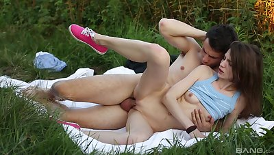Cute unreserved enjoys outdoor orgasms on every side their way girlfriend