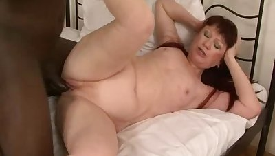 Mature redhead moans with wonder while a malicious man drills her