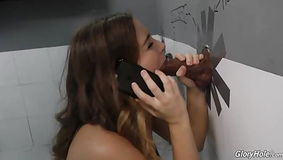 Natasha Ultra-Cute is deep-throating a stranger's sausage thru a gloryhole, near make him flood out from delight