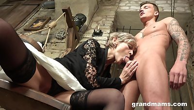 Grey haired mature wrinkled bitch gives her man a solid blowjob
