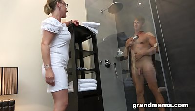 Old woman with high sex avidity enjoys watching lad taking a shower before having sex