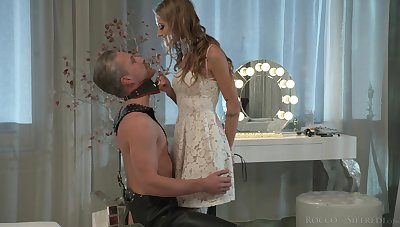 Lecherous mistress Tiffany Tatum punishes her submissive dude on a leash