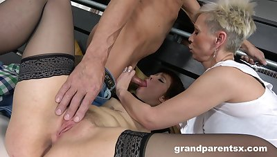Two short-haired sluts hungrily patch a stud's stiff endowment