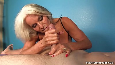 Hot mature pleases man with soft handjob and blowjob