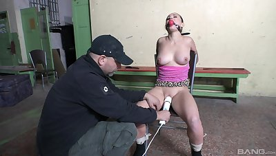 Unveil girl sits gagged and restrained while playing filial