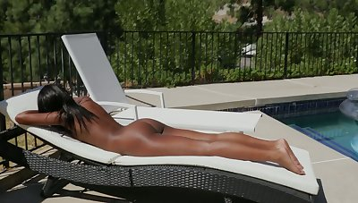 Ebony chick Ashley Aleigh shows her nice big booty and small boobies